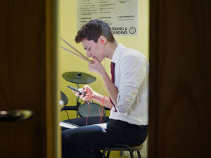 Mobile phone and drum sticks